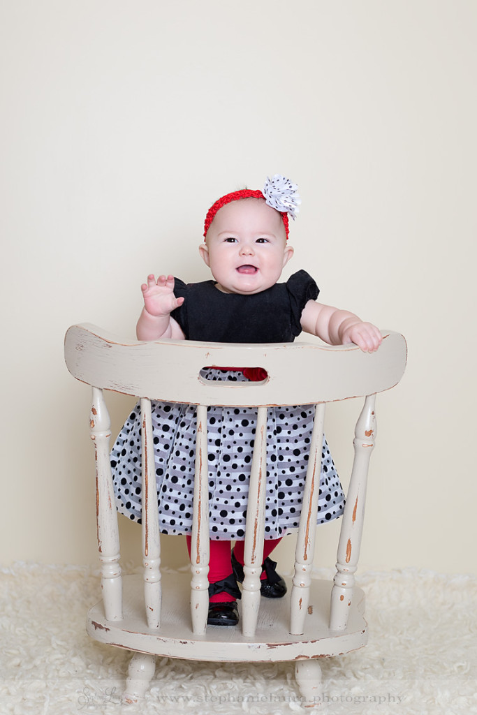 9 month old standing on chair